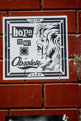 Hope is not obselete (PDKImages) Tags: art street manchesterstreetgallery manchesterstreetart streetart contrasts couple love artinthecity ripartist faces abandoned girl bee bees manchester walls posterart stencilart heart hidden dmstff cityscape cityscene