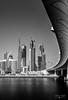 Business Bay (NikolajAlexanderPics) Tags: longexposure burj skyscraper monochrome river dubai cityscape bridge skyline water burjkhalifa
