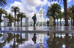 Going home after the rain (PeterThoeny) Tags: ferryterminal ferrybuilding sanfrancisco california city day cloud cloudy outdoor embarcadero architecture tower building water reflection waterreflection symmetry person walk walking tree palmtree nex6 selp1650 1xp lphotomatix hdr qualityhdr qualityhdrphotography