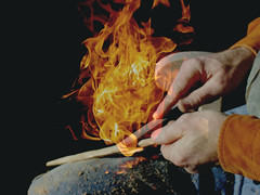 Working with the Fire (MaureenShaughnessy) Tags: winter 15fav orange hot cold yellow closeup 510fav fire tim hands warm glow shine flames prayer working carving heat form ggss coldseason seasonalrhythmsformwinter seasonalrhythmswinter seasonalform