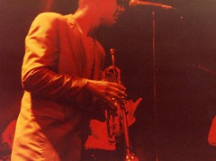 Chas prepares his Trumpet (Bashed) Tags: nottingham uk england music sunglasses rock drums suits europe drum bass live ska saxaphone madness carl sing scanned 1981 british sax suggs cathal nottinghamuniversity bedders chassmash