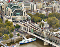 The Country Alliance surround Charing Cross Station (yewenyi) Tags: city uk railroad bridge trees vacation england holiday london water station thames buildings boot march boat europe barca barco footbridge unitedkingdom crowd protest railway pedestrians bateau suspensionbridge charingcross  thamesriver victoriaembankment terminus countrysidealliance protestmarch