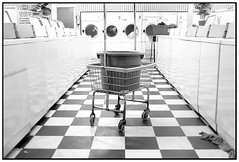 cart on aisle two (slight clutter) Tags: blackandwhite bw galveston topf50 quality laundry iloveflickr washingmachine laundromat washer slightclutter katyahorner slightclutterphotography