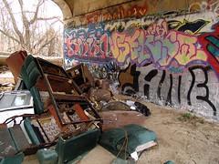 good art destroys the comfortable chair (zen) Tags: colors trash graffiti paint chairs sixwordstory walls 20060309 artistkolon artistroadkill