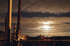 Barbed wire in moonlight (Plutor) Tags: longexposure moon night fence lenstagged factory barbedwire iso1600 minoltasrt202 minolta50f14 naugatuck naugatuckct