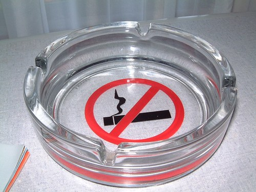 an ashtray with a no smoking sign