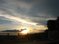 The cloud hugging the sun 3 (marlenells) Tags: sunset sky freeassociation topc25 topv111 clouds 1025fav zoomzoom maring