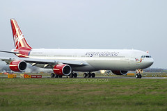 Virgin Atlantic Airways Airbus A340-642 (Greg Bajor) Tags: city uk greatbritain travel sunset red england sky orange holiday france london lines tarmac modern night plane sunrise out airplane nose lights evening fly flying airport wings traffic display unitedkingdom britain dusk heathrow aircraft altitude aviation air united jets airplanes touch great transport flight wing jet fast kingdom gear off aeroplane atlantic landing business virgin international journey american commercial richard depart transportation airline planes airbus arrive take commuter fixed british local arrival airways airports gregory airlines scheme departure baa branson takeoff runway flights atmospheric regional airliner lhr a340 airliners aerospace 340 flaps rotate taxiing livery birdlike landings egll lcy runways 642 bajor wingslet gvfox