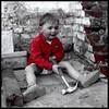 NO need to whistle at passing ladies (kiplingflu) Tags: wood red white black brick smile hammer wall kid shoes bob favme cheeks builder luka hamer interestingness241 i500