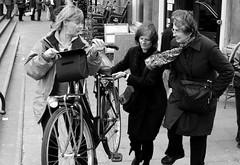 Jodenbreestraat, Amsterdam (prupert) Tags: people bw woman amsterdam bike bicycle geotagged glasses lenstagged candid streetphotography canonef1740mmf4lusm jodenbreestraat pimrupert geolat5236953931242583 geolon4901497053779626