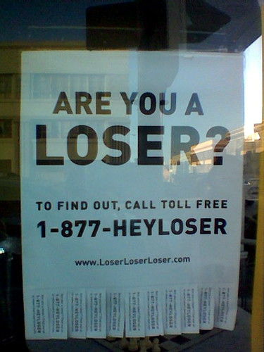 flier asks are you a loser? call 1-877-heyloser