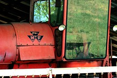 Reflections Of An Old Massey Ferguson Combine (vtengr4047) Tags: red reflection glass field grass logo cabin day outdoor farm rusty combine operators mf agriculture masseyferguson