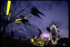 Night Ride (jetrotz) Tags: carnival film night purple screensaver swing savannah portfolio myfave