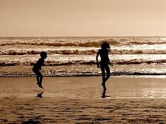 Just a little jump...... Yippee (Earlette) Tags: morning summer beach sepia kids children jumping holidays surf australia goldcoast tccomp076