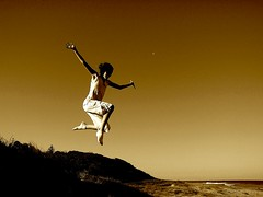 Jumping with elegance.... (Earlette) Tags: autumn moon beach girl silhouette sepia kids children fun jumping sand australia newsouthwales ash leap elegance oldbar midnorthcoast