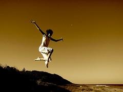 Jumping with elegance.... (Earlette) Tags: autumn moon beach girl silhouette sepia kids children fun jumping sand australia newsouthwales ash leap elegance oldbar midnorthcoast