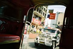 Jeepney to Jeepney (eesti) Tags: city travel film car sign asian lomo lca lomography asia jeep kodak philippines transport toycamera 2006 manila 400uc jeepney philippine russiancamera