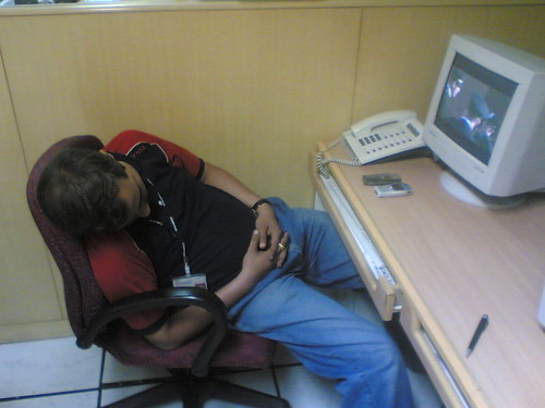 Man asleep at desk.
