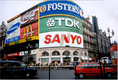 Piccadilly Circus in July 1998. (Steve Brandon) Tags: street england people 15fav london boots unitedkingdom britain taxi crowd gap samsung panoramic mcdonalds piccadillycircus sanyo cocacola scenes 1990s  streetscenes tdk londoncab fostersbeer
