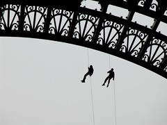 Two Firemen (Leucippus) Tags: blackandwhite bw paris france arch exercise steel eiffeltower climbing toureiffel firemen practice rappel abseiling firefighters roping abseil criticismwelcome