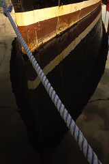Roped In (Bhlubarber) Tags: orange reflection film water vancouver boat industrial rusted hull provia industrialorange davidniddrie
