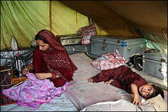 Sewing in a tent - Muzaffarabad (Maciej Dakowicz) Tags: life pakistan camp people woman canon photography eos earthquake october ruins child tent relief help 5d kashmir journalism muzaffarabad balakot