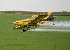 Crop Duster (Jenni Reynolds-Kebler) Tags: tractor field plane airplane fly flying aircraft aviation air crop duster 100views agriculture cropduster 900views airtractor
