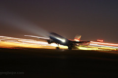 Commercial airplane taking off at night (Greg Bajor) Tags: uk travel blue england sky abstract london tarmac modern night speed plane airplane lights fly flying airport wings movement er display action heathrow aircraft aviation air united wing jet kingdom off aeroplane landing journey commercial take commuter fixed british ba boeing airways takeoff 777 runway impression airliner lhr aerospace advanced rotate taxiing 236 egll wingslet birdlikeimages gregbajor