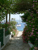 There she is! (Lazy B) Tags: flowers sea sun white yacht picturesthroughholes may 2006 greece walls archway fz5 corfu kalami btly