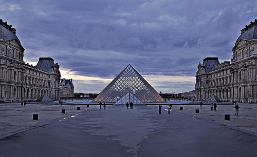 Rita Crane Photography:  Paris / Architecture / I.M Pei / Musee du Louvre / dusk / buildings / people / Pyramid at the Louvre, Cour Napoleon, Paris