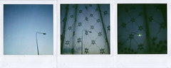 ...triptych (the3robbers) Tags: blue light net lamp polaroid triptych time barry joyce the3robbers