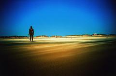 Lonely (lipsticklori) Tags: beach lomo lca crossprocessing gormley crosby