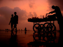 Under Karachi's Maroon Skies... (ali khurshid) Tags: pakistan sunset sea love beach colors silhouette clouds solitude time availablelight calm serene unreal karachi clifton cotc changinglight flickrexplorepage exploretop20 exhibition14august cotcmostviews 16thjuly2006 marchexhibition2007