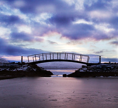Bridge (Svavar Trausti) Tags: bridge sunset sea sky snow color ice beach colors wow landscape landscapes rocks harbour bridges sunsets frosted bonzag