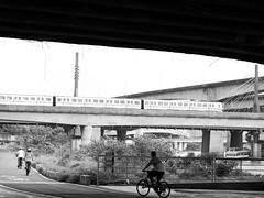 Riverside, Taipei (imnOthere0) Tags: street bridge blackandwhite bw monochrome bicycle river boat candid taiwan bikes taipei mrt streetview keelung imnothere0