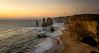 The sunset at the 12 Apostles (jh_tan84) Tags: australia greatoceanroad the12apostles sunset water ocean sky clouds orange limestones apostles landscape nikon