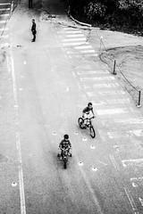 Pomeriggi svogliati (Simone.Marengo) Tags: bicycle bicycles children peolple bw perspective street play ride game games afternoon summer