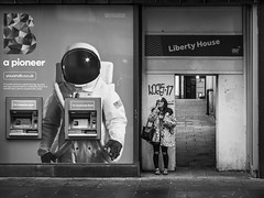 Cosmic (Leanne Boulton) Tags: monochrome urban street candid portrait streetphotography candidstreetphotography streetlife urbanlandscape eyecontact candideyecontact woman female girl face facial expression posture smoke smoker smoking cigarette spotted juxtaposition space spaceman astronaut humour humorous tone texture detail depth natural outdoor light shade shadow city scene human life living humanity people society canon 5d 5dmarkiii 70mm ef2470mmf28liiusm black white blackwhite bw mono blackandwhite glasgow scotland uk