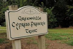 Greenville - Trust (Drriss & Marrionn) Tags: bluestrail2014 outdoor bayou swamp nature preserve green tree trees cypresstrees water creek sign signboard text plaque greenvillecypresspreserve naturepreserve