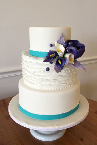 Purple and Teal Wedding cake with Sugar Cala Lilies and Fondant Ruffles