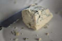 Say Cheese! for Macro Mondays - HMM! (suzanne~) Tags: macromondays saycheese macro tabletop food cheese roquefort bluecheese indoor stilllife dairy lensbabyvelvet56 lensbaby blur dof crumbs knife