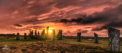 The sun sets over the Callanish Stones (Impact Imagz) Tags: callanish callanishstones sunset cloudsstormssunsetssunrises cloudscapes isleoflewis historicscotland outerhebrides westernisles scotland