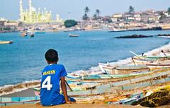 Two Worlds & a Jersey (shubhankrishi) Tags: street travel blue sea india boats fishing fisherman village 4 kerala jersey mahesh fishingvillage footballjersey trivendrum