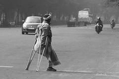 Risky negotiation (pathikdebmallik) Tags: road india crossing risk kolkata calcutta crutch difficulty