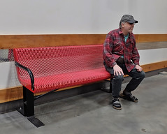 Stu At CostCo-HBM! (Busy Packing-Sorry 4 Not Commenting!) Tags: bench benchmonday metal red stu waiting wall costco man hat greay shirt blue pants black shoes socks floor concrete wood chairrail