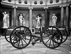 Guns and Poses (National Library of Ireland on The Commons) Tags: robertfrench williamlawrence lawrencecollection lawrencephotographicstudio thelawrencephotographcollection glassnegative nationallibraryofireland guns statues artillery roundhall polishedfloor figleaf cannon nationalmuseumofireland kildarestreet rotunda mosaic sikhcannon museum aphrodite hermes sophocles dublin sikhwars anglosikhwar flick battleofsobraon gough explore