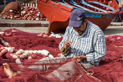 With the Help of His Big Toe (Matthias58) Tags: people man ma ship harbour places equipment morocco vehicle essaouira marokko fishermanboat netmending canoneos6d marrakechtensiftalhaouz canonef2470mmf28liiusm