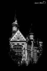 Black Castle (meepeachii) Tags: bw mountains alps castle tourism nature germany dark bayern deutschland bavaria natur sightseeing berge alpen neuschwanstein lowkey dunkel tourismus allgäu sehenswürdigkeit schwarzweis dünster followerspecial
