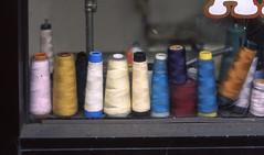 spindles (wigmore126) Tags: thread nikon fuji sewing yarn velvia shopwindow bobbins velvia50 nikonfm epsonv500