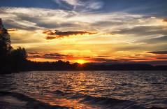 The day ends windy at the lake (dannicamra) Tags: light sunset sky sun sunlight lake nature water clouds germany landscape bayern bavaria see licht nikon wasser sonnenuntergang outdoor natur himmel wolken dmmerung sunrays ufer landschaft sonne sonnenstrahlen steinbergersee d5100